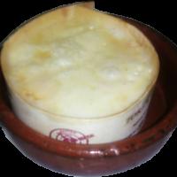 Torta de barros (queso fundido, servido con pan tostado)